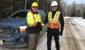 """Mike Maxfield, certification superintendent with Resolute Forest Products, and Chris Serratore, prevention services director at Workplace Safety North, announce the new Ontario training course """"Safe Driving on Forest Roads,"""" designed for workers and the public to help prevent collisions of large trucks, passenger cars, trucks, snowmobiles, and ATVs on forest access roads. Photo: Workplace Safety North"""